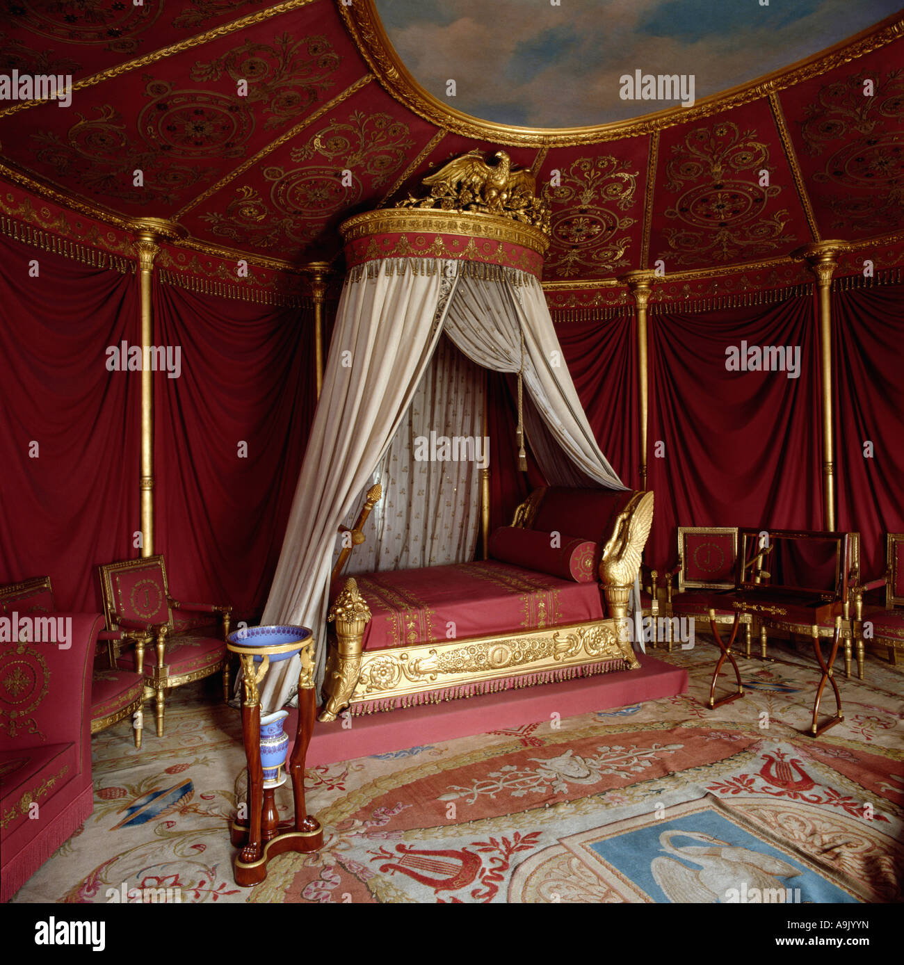 Bedroom ceiling drapes - Ornate Gold Coronet With Cream Drapes On Baroque Gold Bed In Eighties Bedroom With Ornamental Ceiling