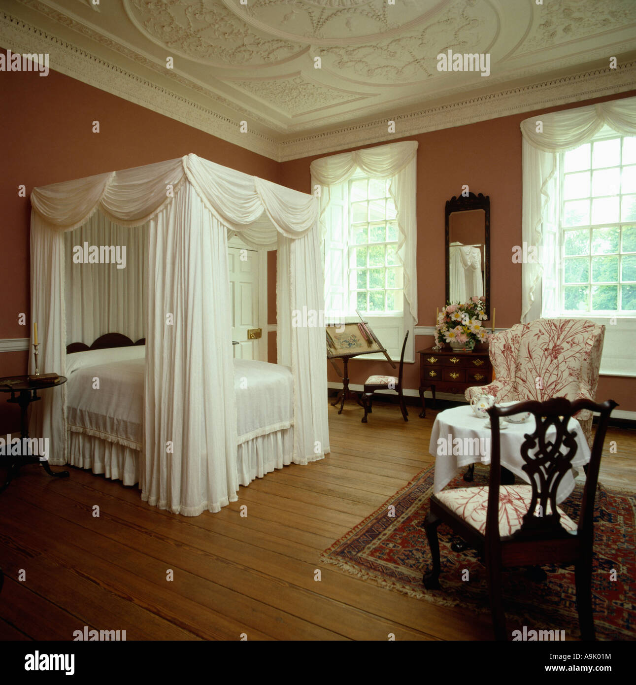 White Wooden Four Poster Bed Part - 49: Four-poster Bed With White Drapes And Linen In Terracotta Bedroom With Tall  Windows And Polished Wood Floor