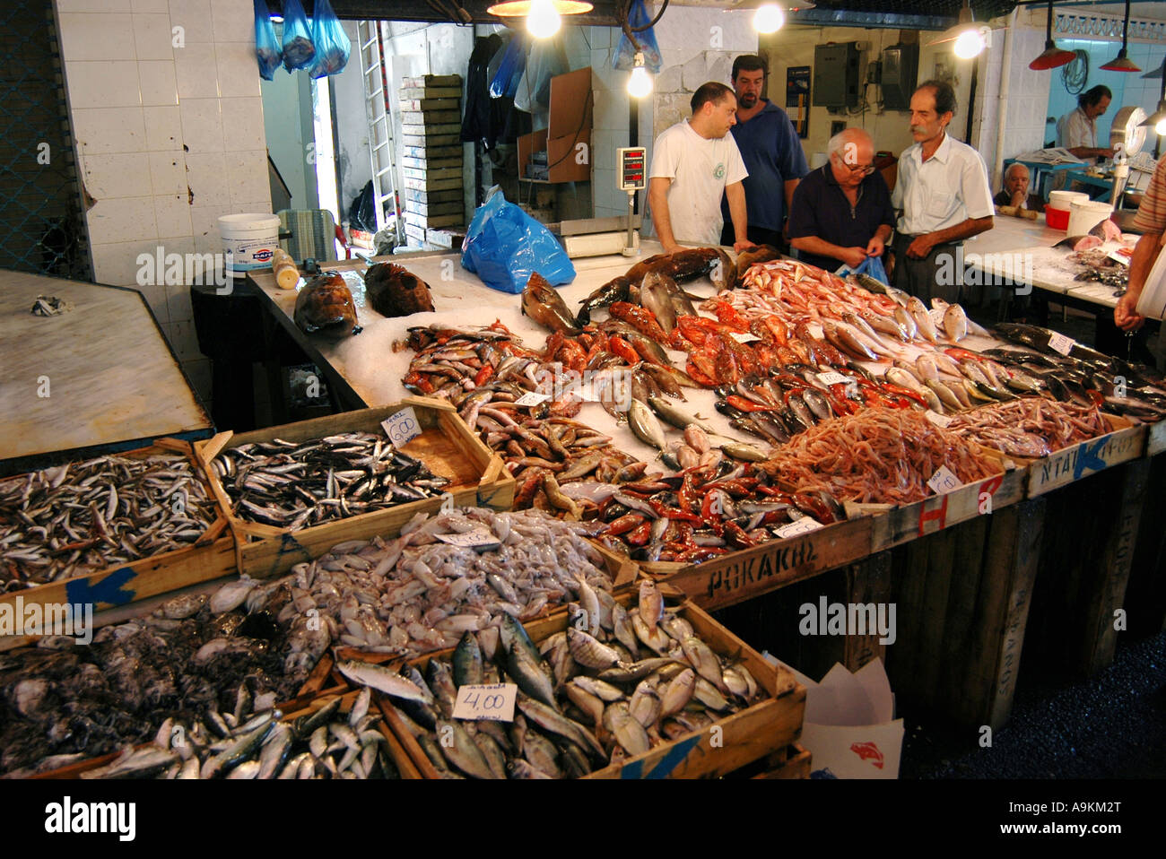 Fresh wet fish stall in a local street market chania crete for Local fish market