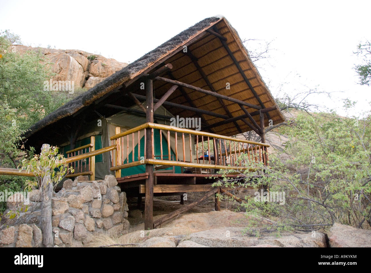 Thatched roof chalet tent at Erongo Wilderness Lodge guest farm in Namibia & Thatched roof chalet tent at Erongo Wilderness Lodge guest farm in ...