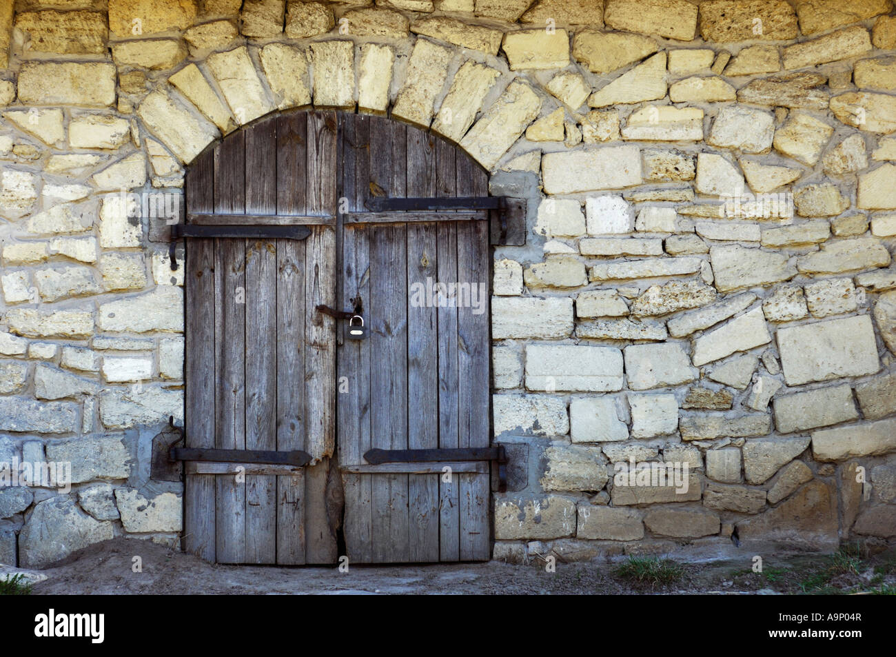 953 #886F43 Old Stone Wall With An Arched Wooden Door Texture Stock Photo Royalty  image Arched Wood Entry Doors 40831300