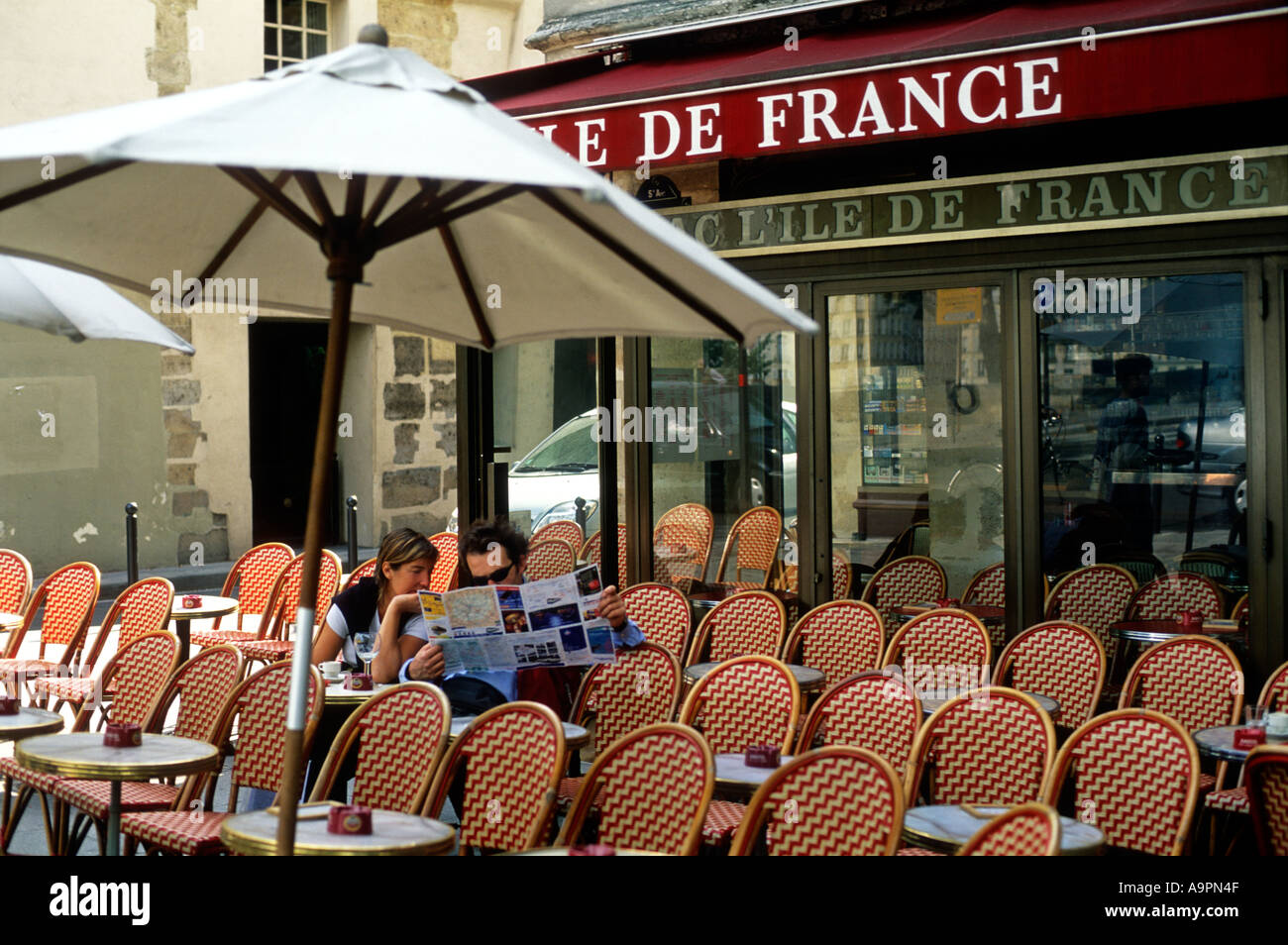 France Paris A Couple Reading A Street Map At An Empty Cafe – Streetmap France