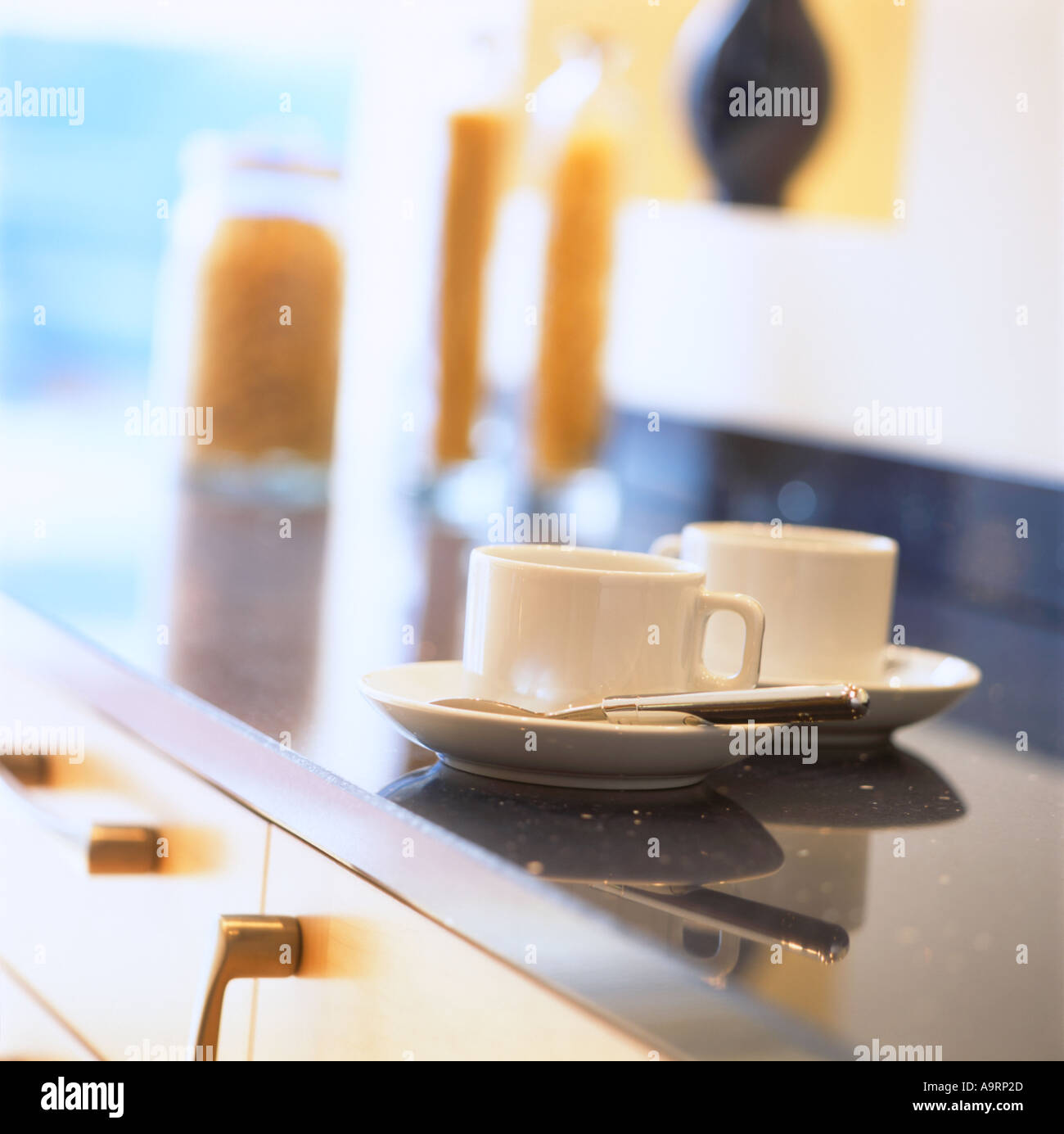Two coffee cups on a modern kitchen work surface with pasta jars out stock photo royalty free - Stylishly modern kitchen islands additional work surface ...