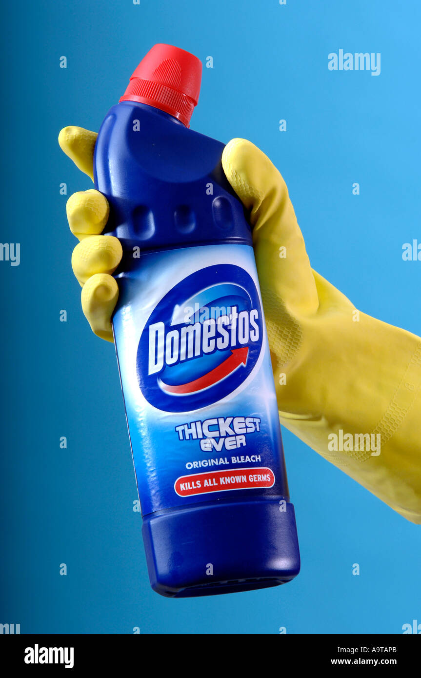 Generic Of Yellow Cleaning Gloves Holding Domestos Bleach