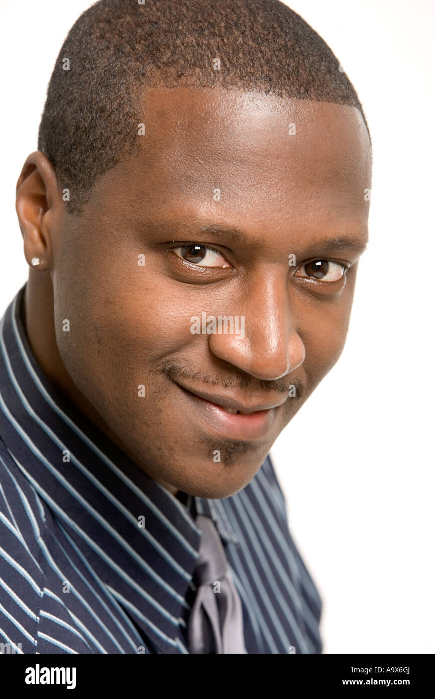 Young black man in collar and tie wearing a small diamond earring ...