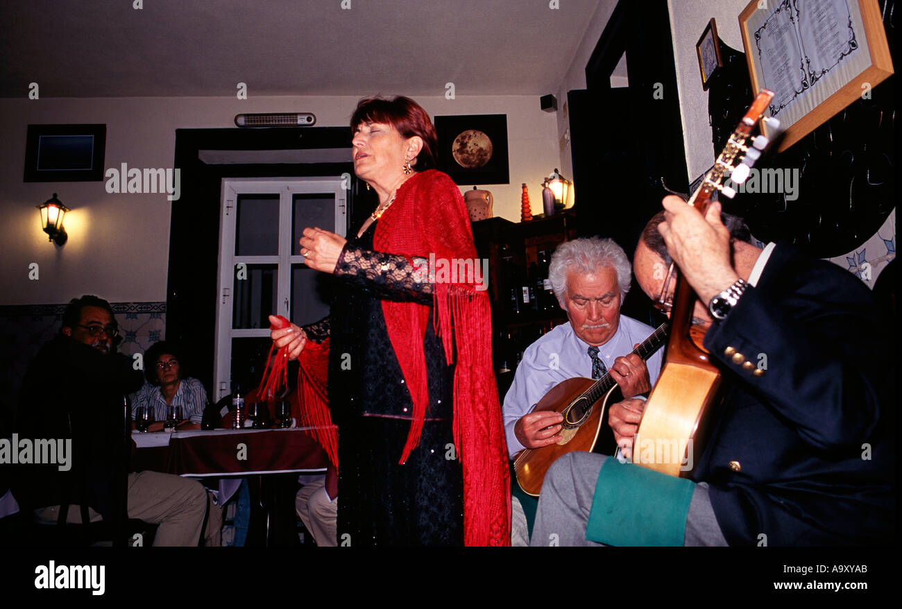 fado singer in restaurante escondidinho at estoril near lisbon stock photo royalty free image. Black Bedroom Furniture Sets. Home Design Ideas