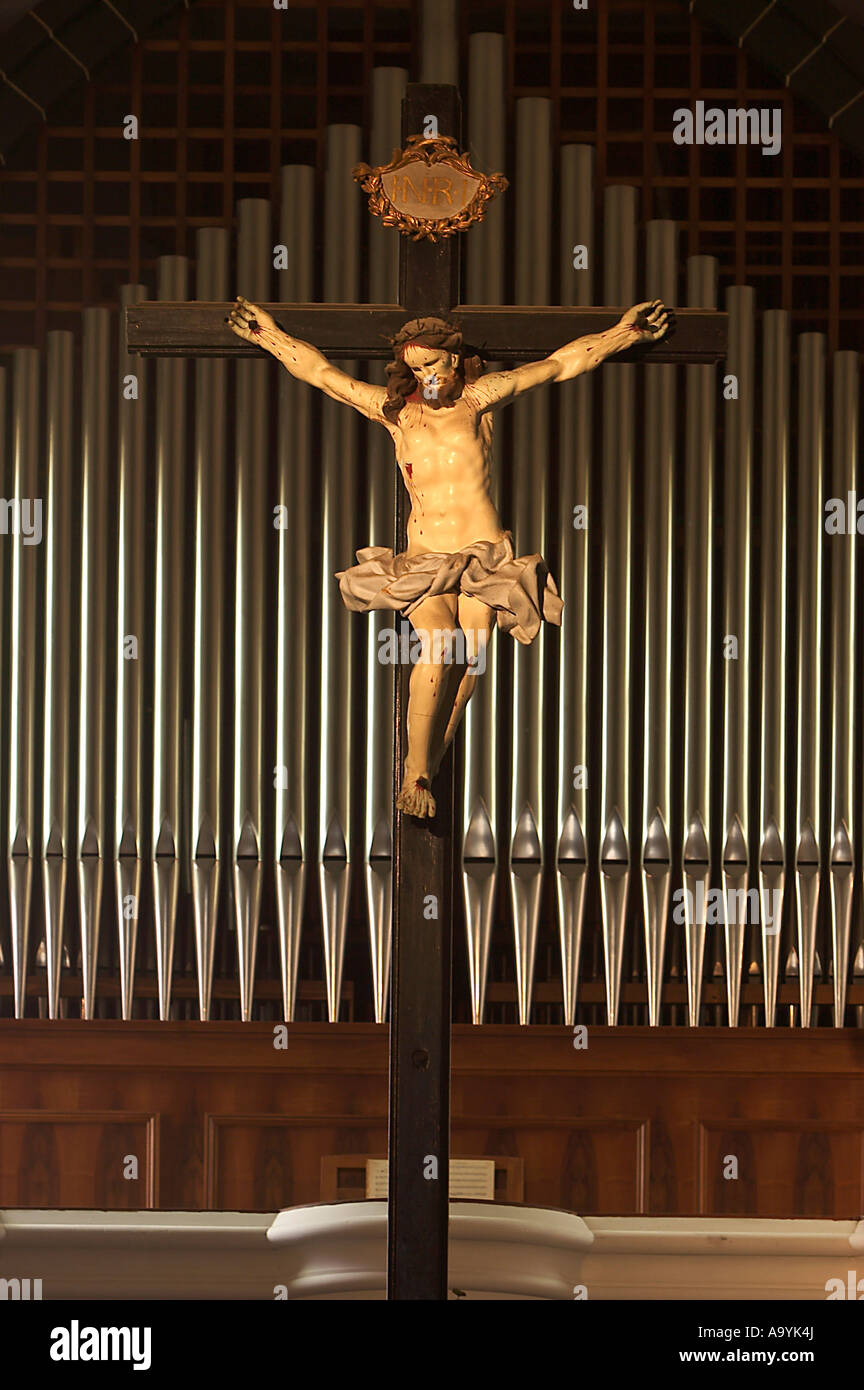 jesus on the cross in front of the organ of church sant andrea