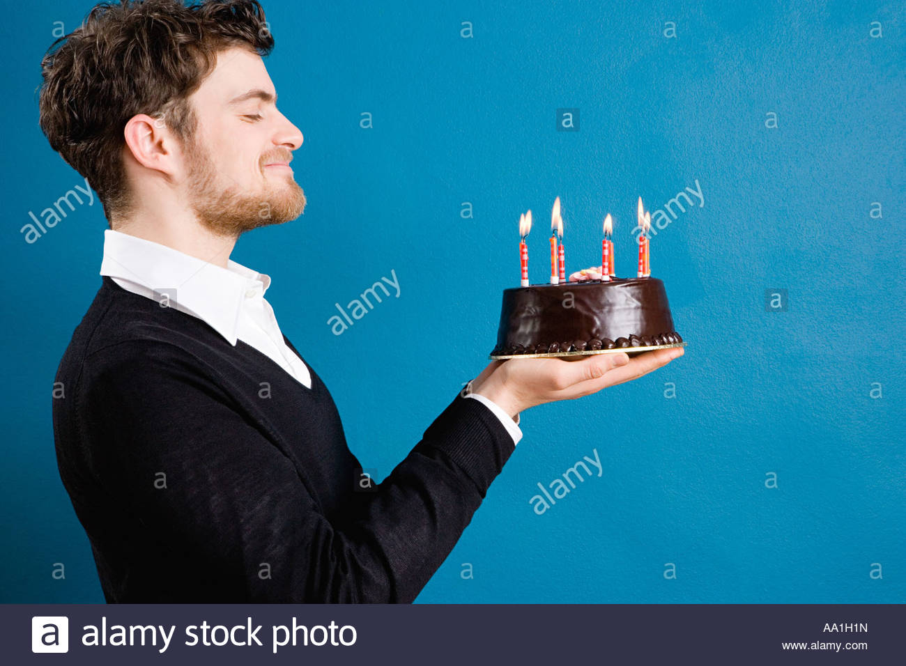 Young man with a birthday cake Stock Photo Royalty Free Image