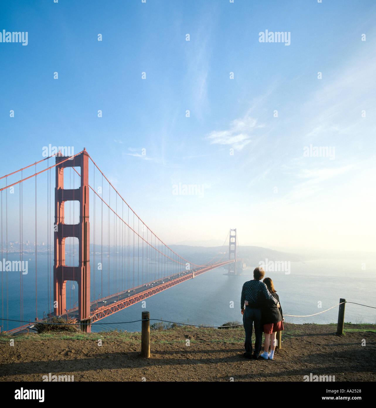 Golden Gate Bridge San Francisco California Sunset Picture: Couple Looking Out Over The Golden Gate Bridge, San