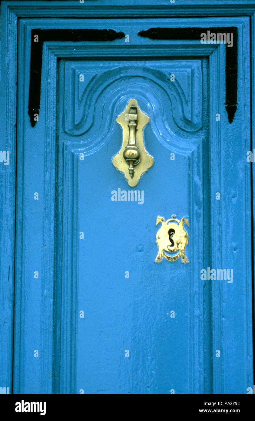 Stock Photo   Traditional Detailed Spanish Door In Bright Turquoise Blue  With Gold Door Furniture And Iron Brackets