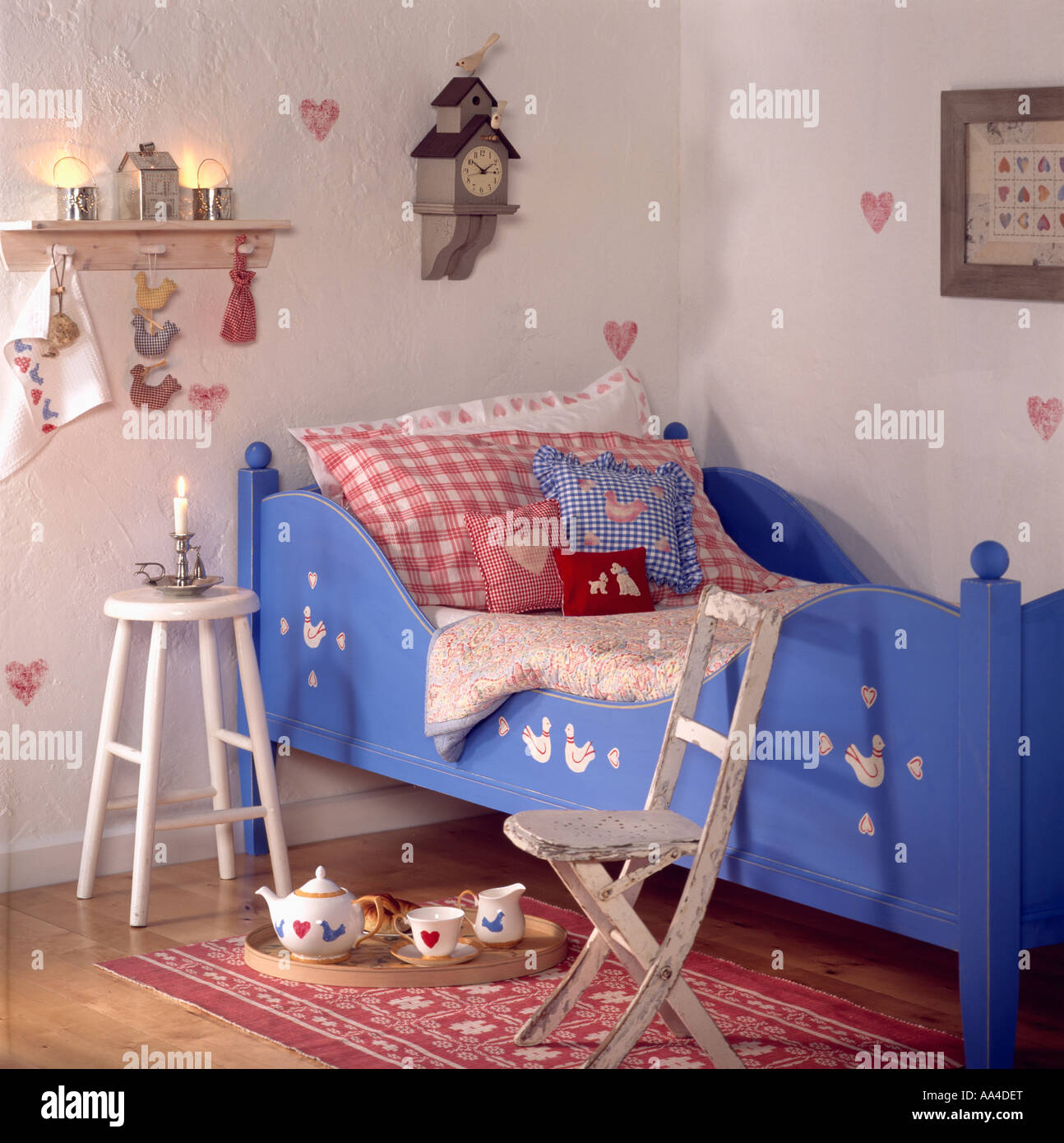 child s shaker style bedroom with blue wooden bed and cuckoo clock child s shaker style bedroom with blue wooden bed and cuckoo clock on wall