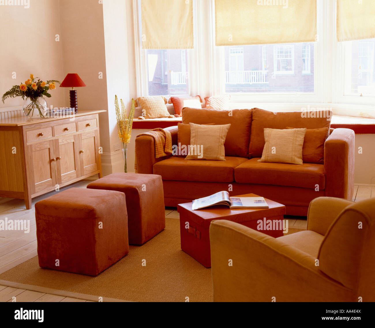Modern Livingroom With Terracotta Sofa And Upholstered Stools And Stock Photo Royalty Free