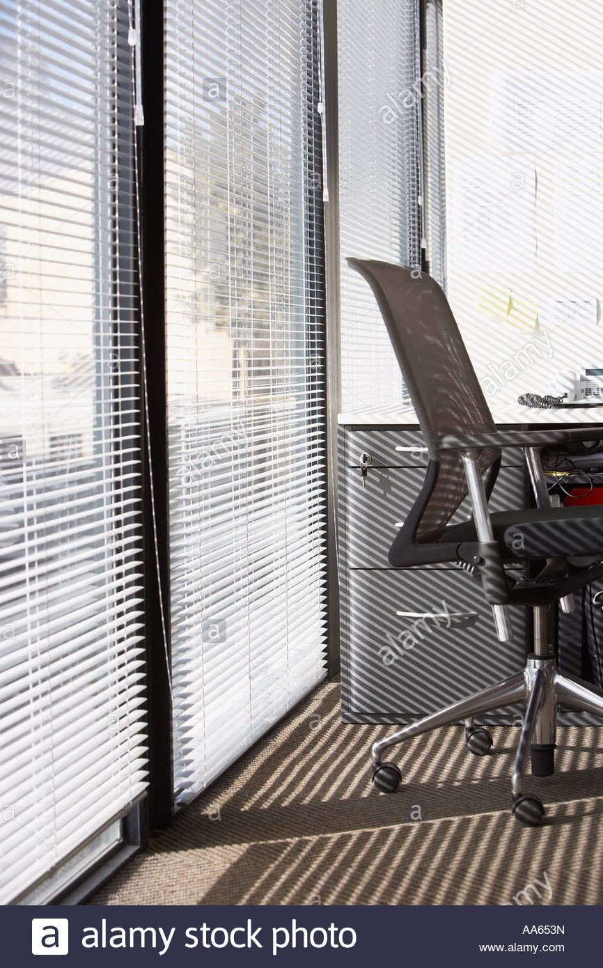Horizontal blinds for large windows - Office Chair With Horizontal Blinds On Large Windows