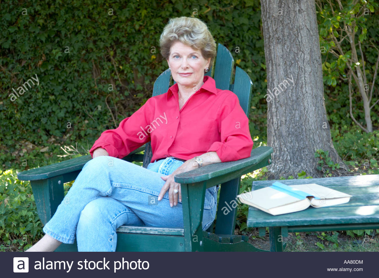middle aged woman relaxing in backyard stock photo royalty free