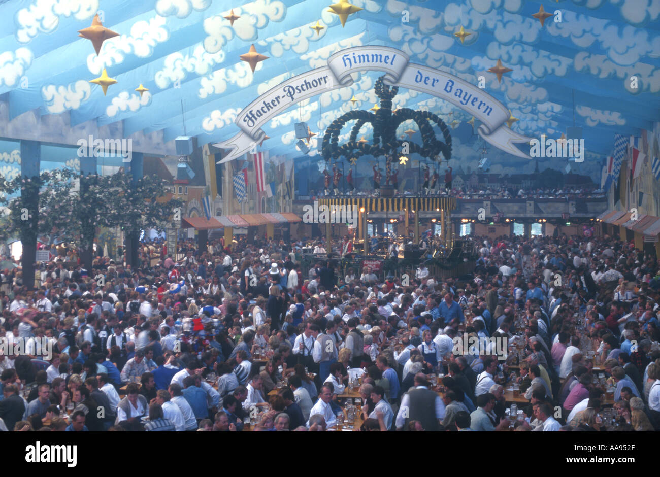 people in the huge beer tent of the Hacker Pschorr brewery on the Oktoberfest Munich Bavaria Germany Europe & people in the huge beer tent of the Hacker Pschorr brewery on the ...