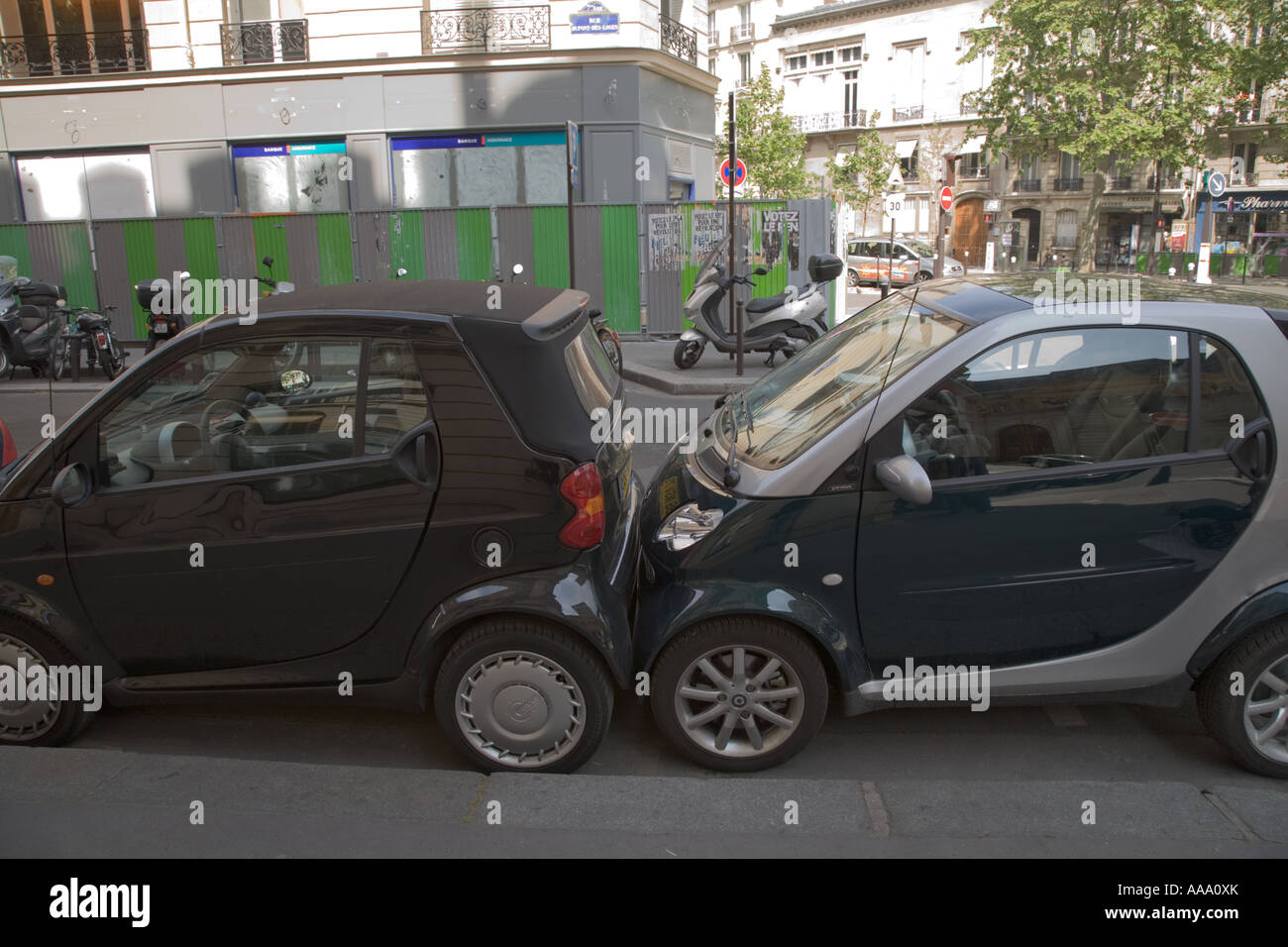 smart cars parked touching bumper to bumper in paris stock photo royalty free image 12563130. Black Bedroom Furniture Sets. Home Design Ideas