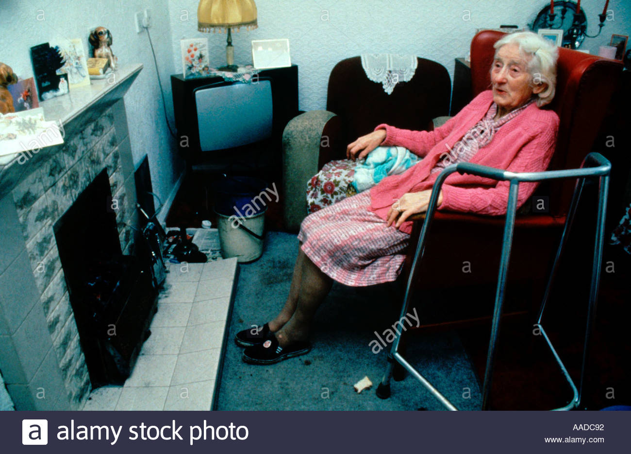elderly-woman-looking-cold-sitting-in-fr