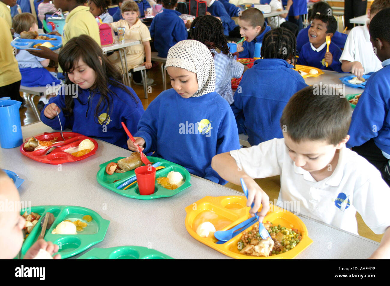 Primary school canteen with children eating lunch Stock ...