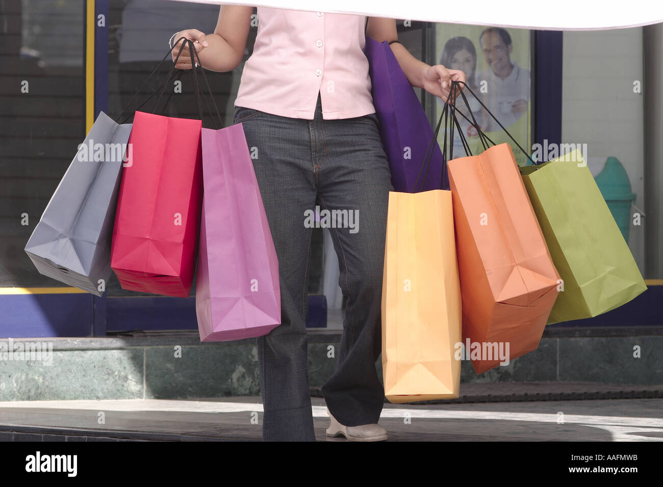 Shopping bags six three in both hands held by lady girl women in ...