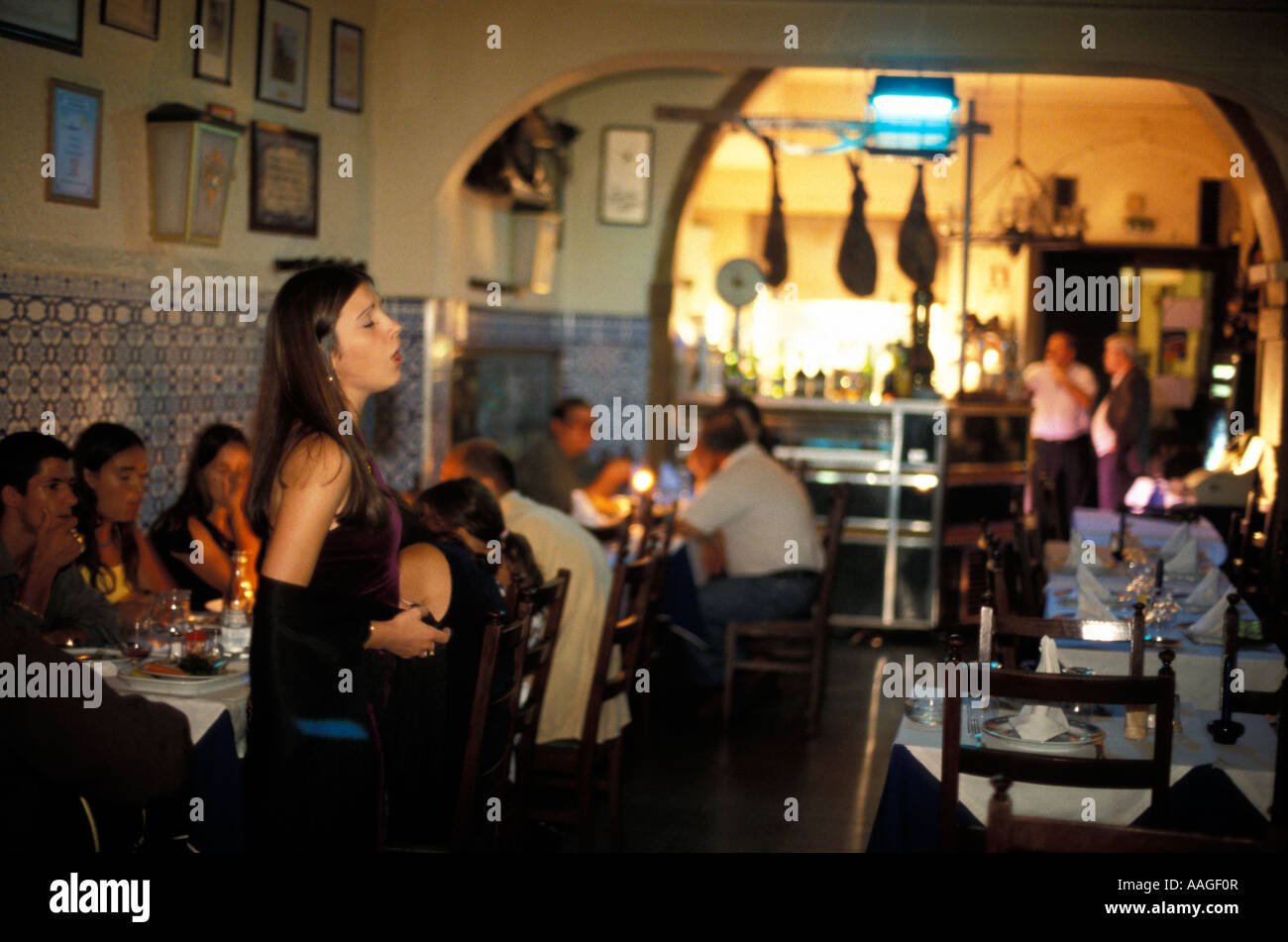 fado singer os ferreiras restaurant mouraria lisbon portugal stock photo royalty free image. Black Bedroom Furniture Sets. Home Design Ideas