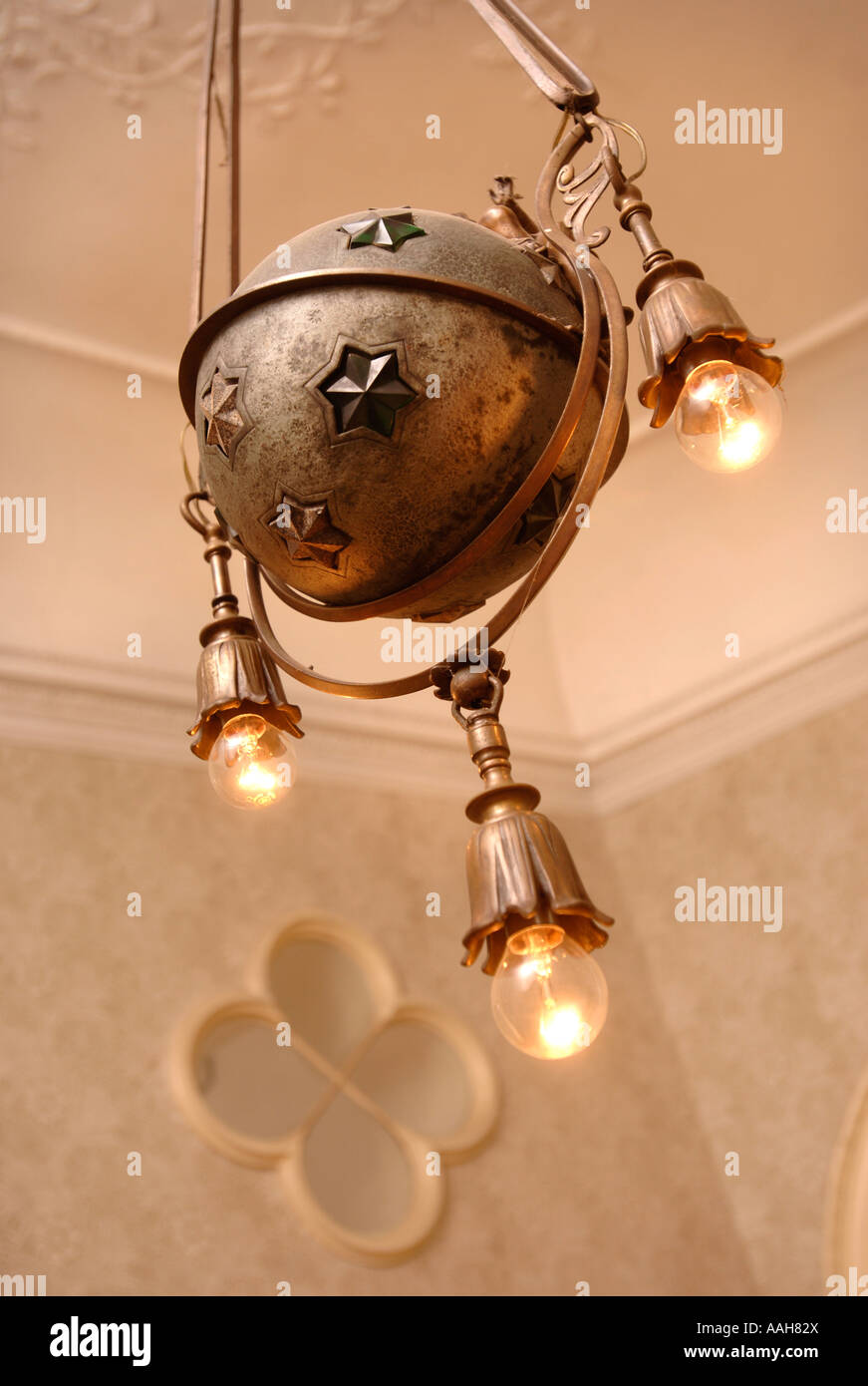 AN UNUSUAL CHANDELIER WITH THREE LIGHT BULBS UK Stock Photo ...