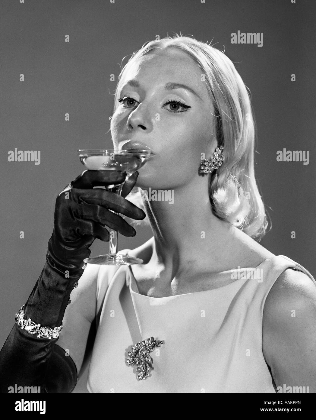 Black gloves for gown - 1960s Elegant Portrait Blond In Gown Long Black Gloves Sipping Champagne