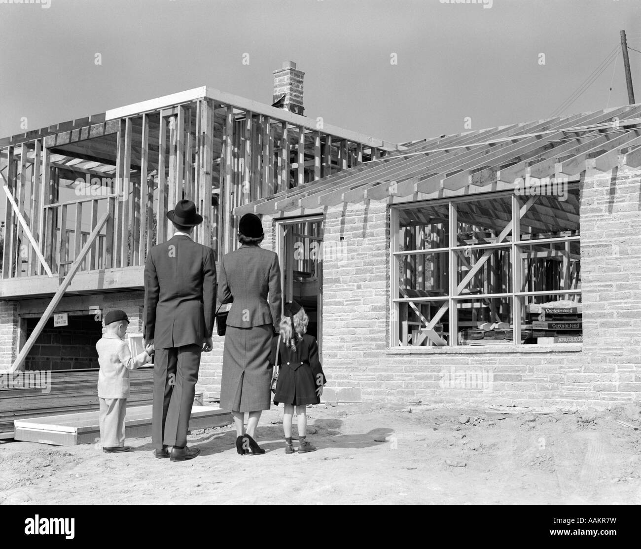 1950s Family Looking At New Home Under Construction Stock
