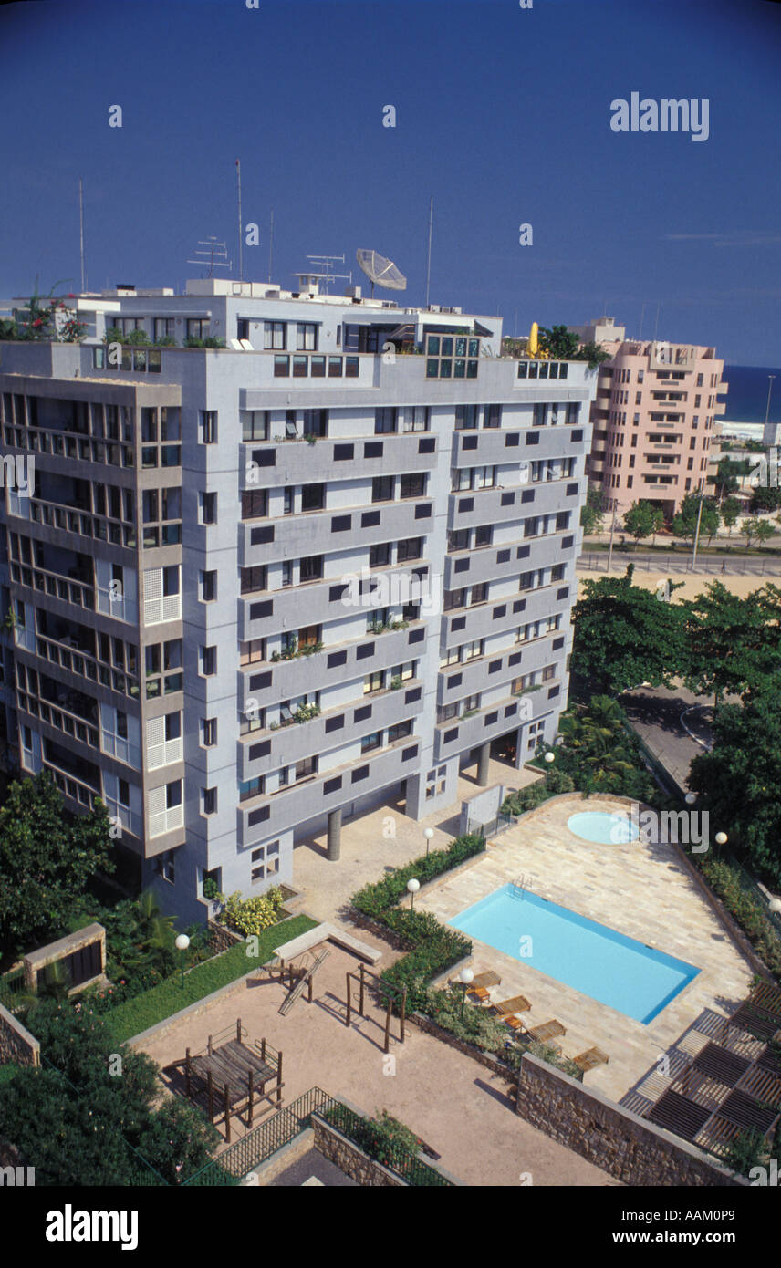 Nice Apartment Building With Swimming Pool. Medium Class Dwelling. Housing.  Barra Da Tijuca Quarter In Rio De Janeiro, Brazil