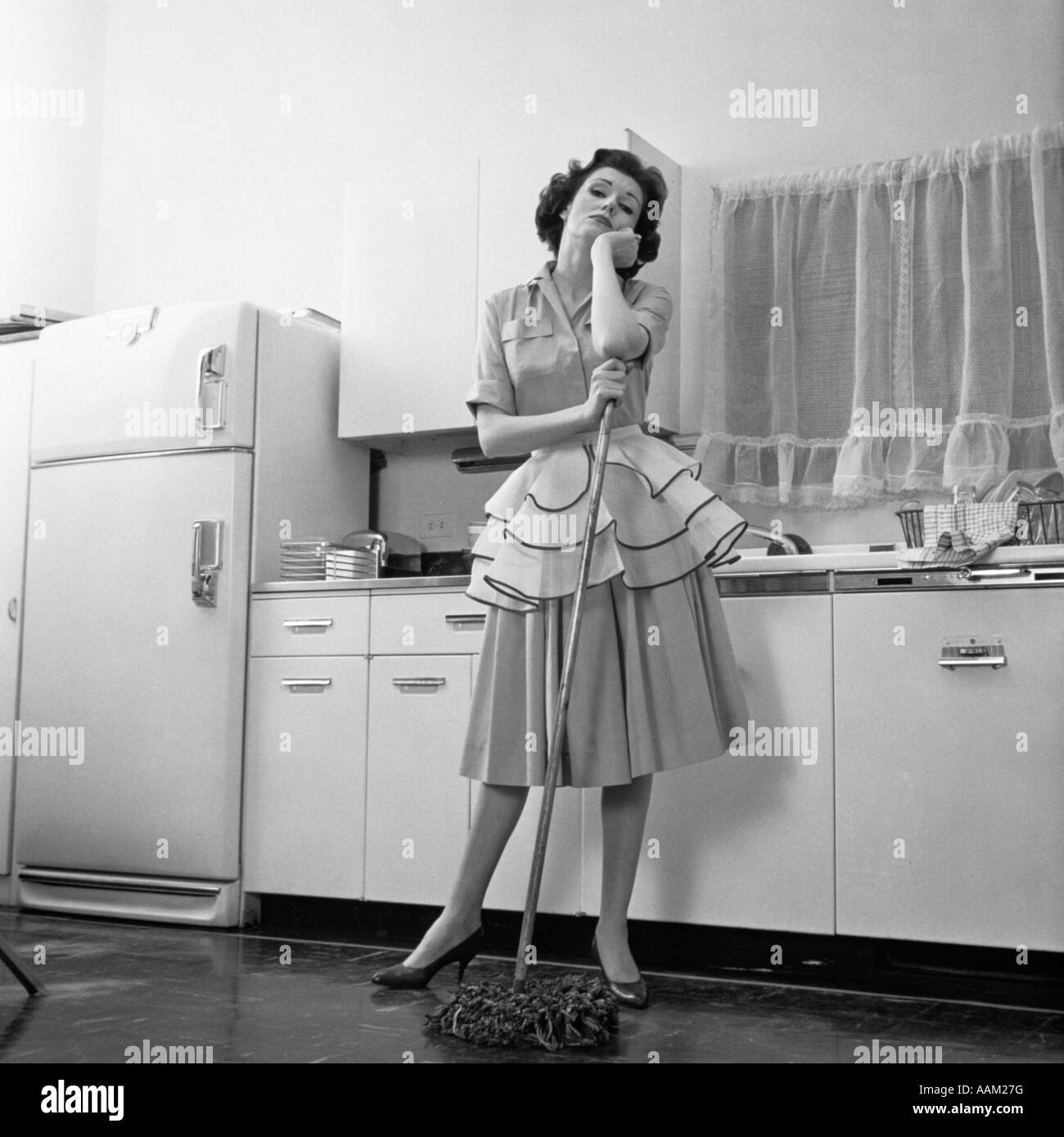 Kitchen Floor Mops 1950s Bored Woman Housewife Wearing Apron Leaning On Mop On