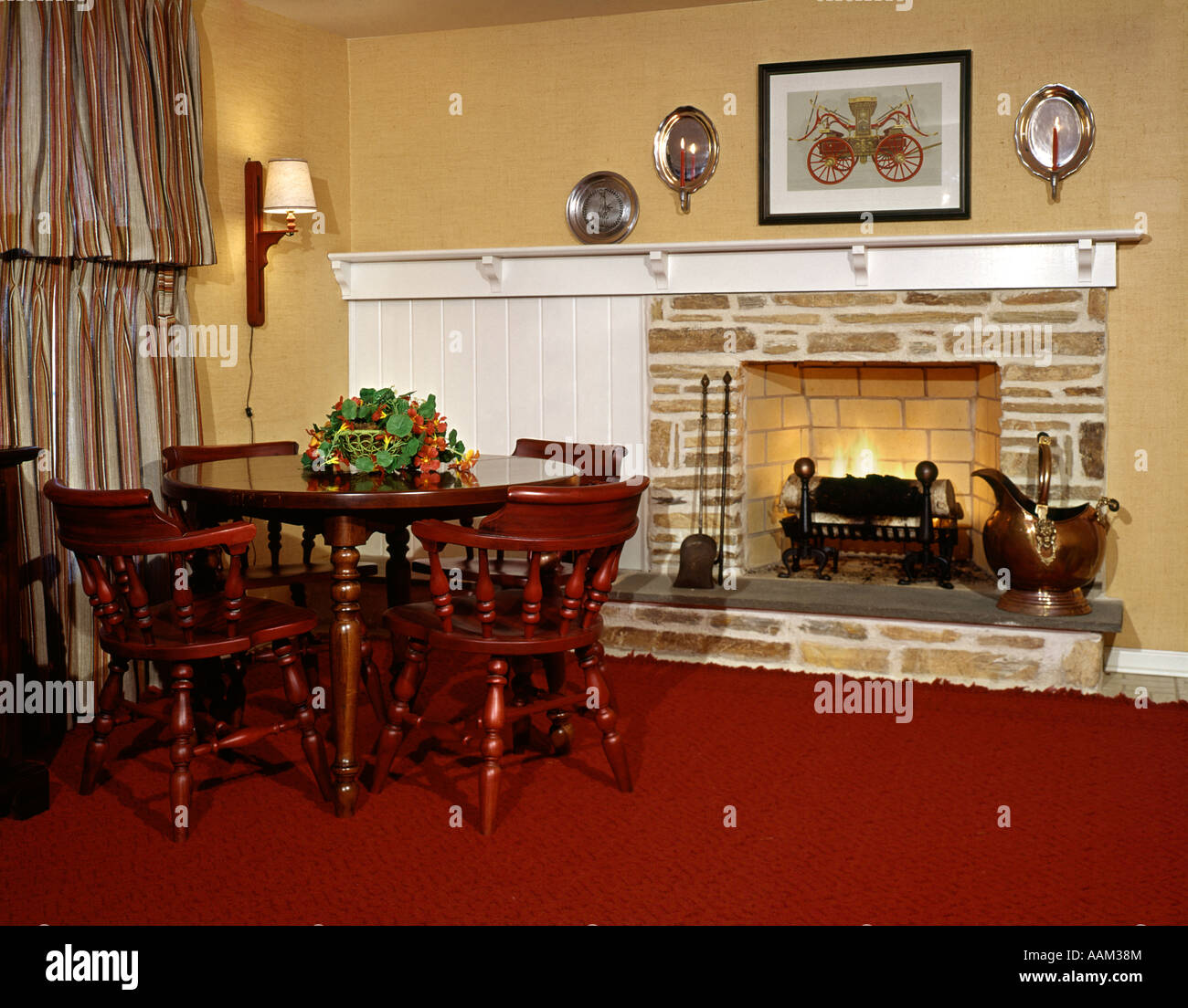 Attractive 1960s 1970s WOOD BURNING FIREPLACE STONE INTERIOR COUNTRY COLONIAL FURNITURE  TABLE CHAIRS RED CARPET SCONCES MANTLE