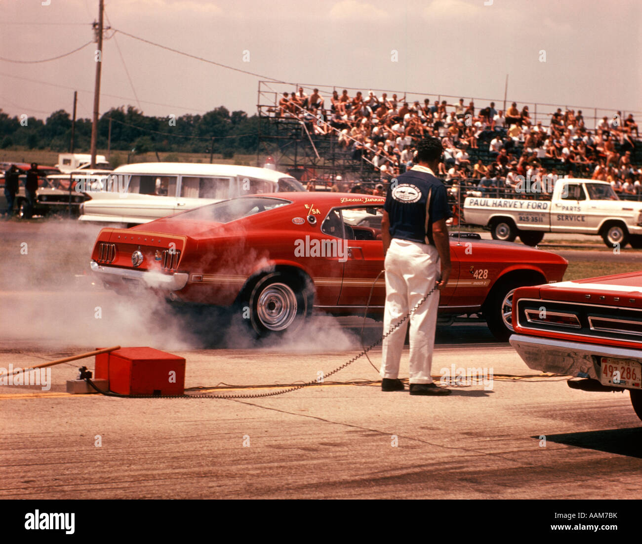 Pit Mechanic By Race Car Burning Rubber Drag Racing