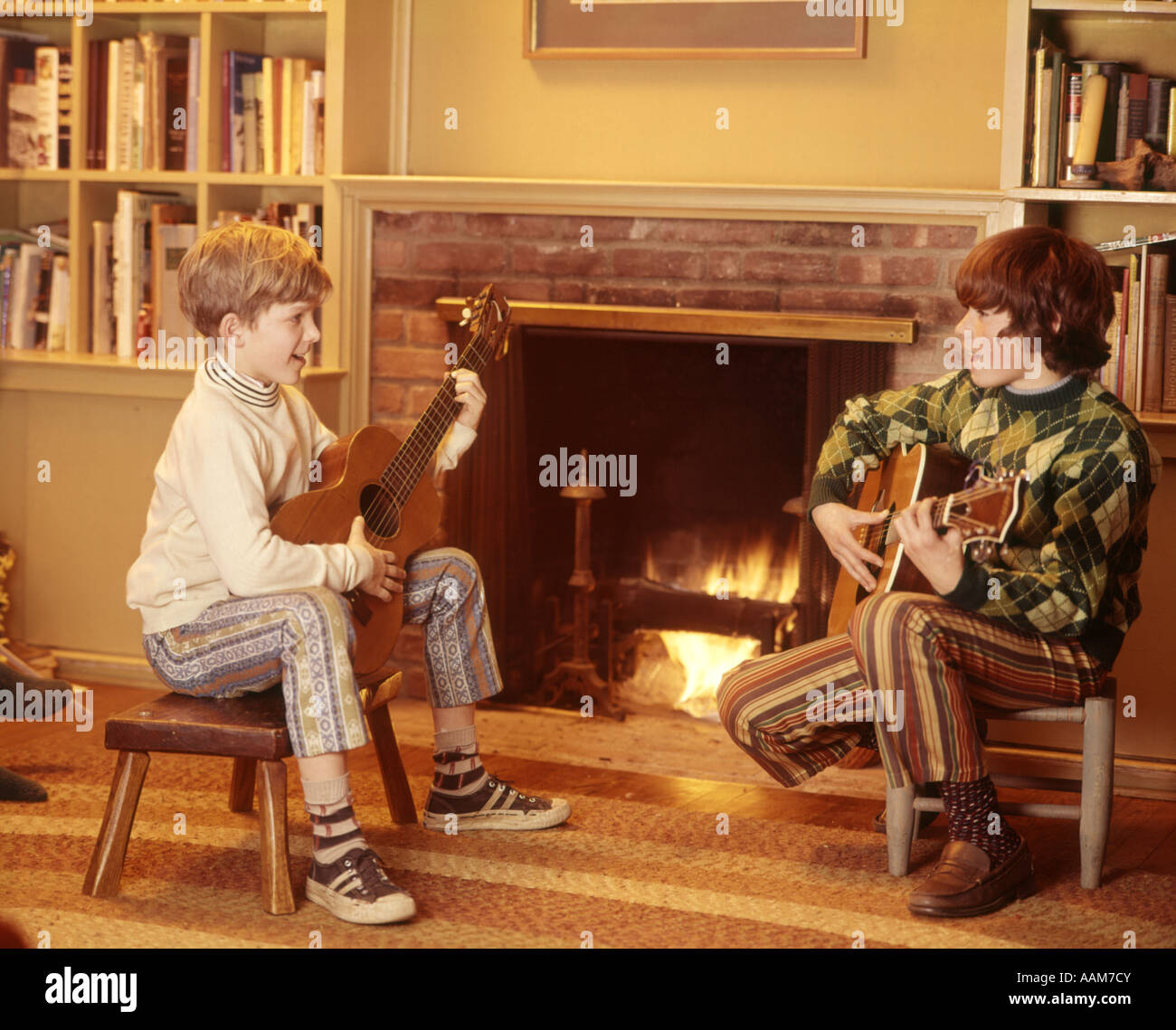 1970 1970s 2 BOYS FRONT FIREPLACE PLAY PLAYING STRUMMING GUITARS ...