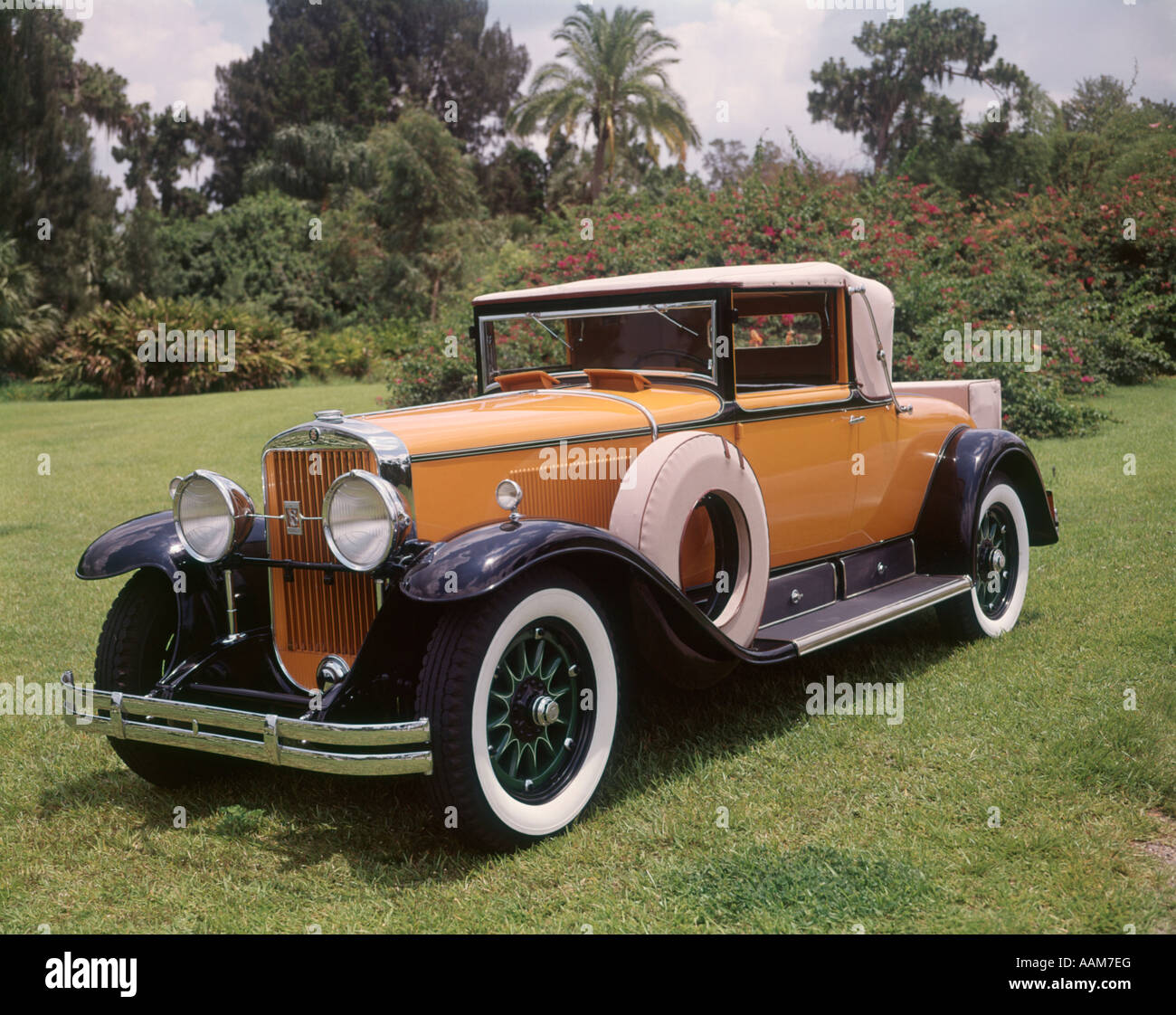 1920s 1930s cadillac convertible roadster yellow and black with stock photo royalty free image. Black Bedroom Furniture Sets. Home Design Ideas
