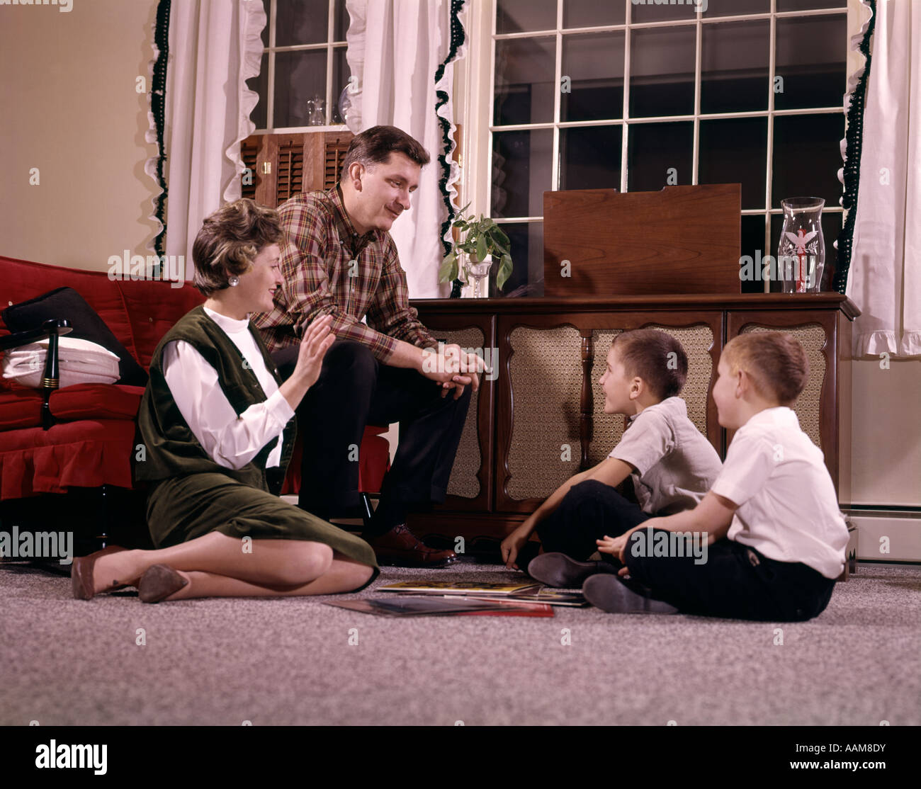 Music Living Room 1960s Family With Two Sons Gathered Around Record Player Listening