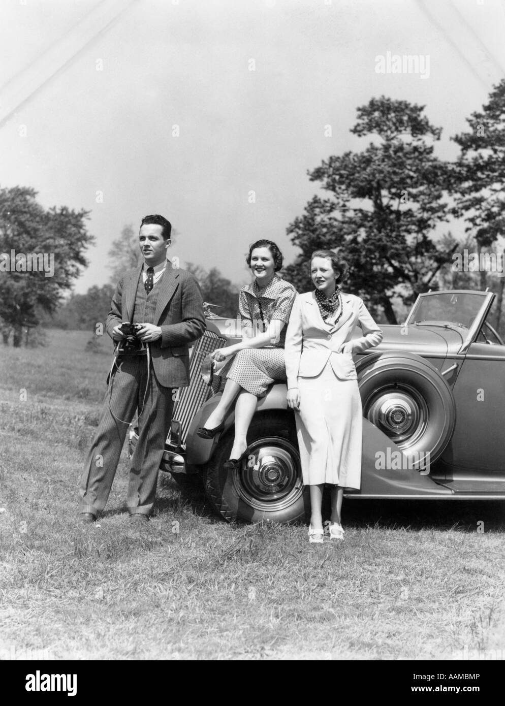 1930s man with camera and two women in front of convertible car style stock photo royalty free. Black Bedroom Furniture Sets. Home Design Ideas