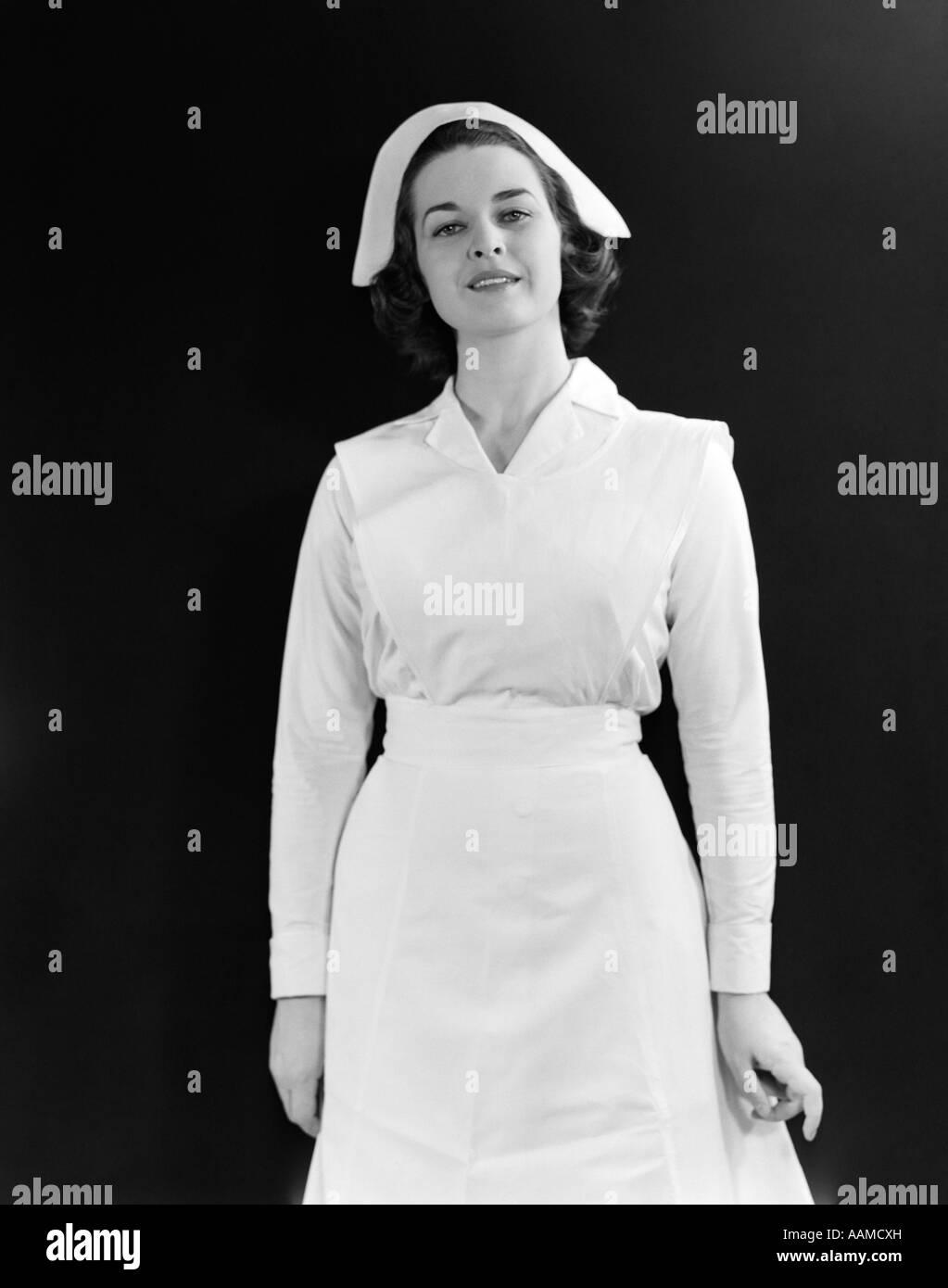 1950s 3 4 Length Portrait Smiling Brunette Nurse Stock