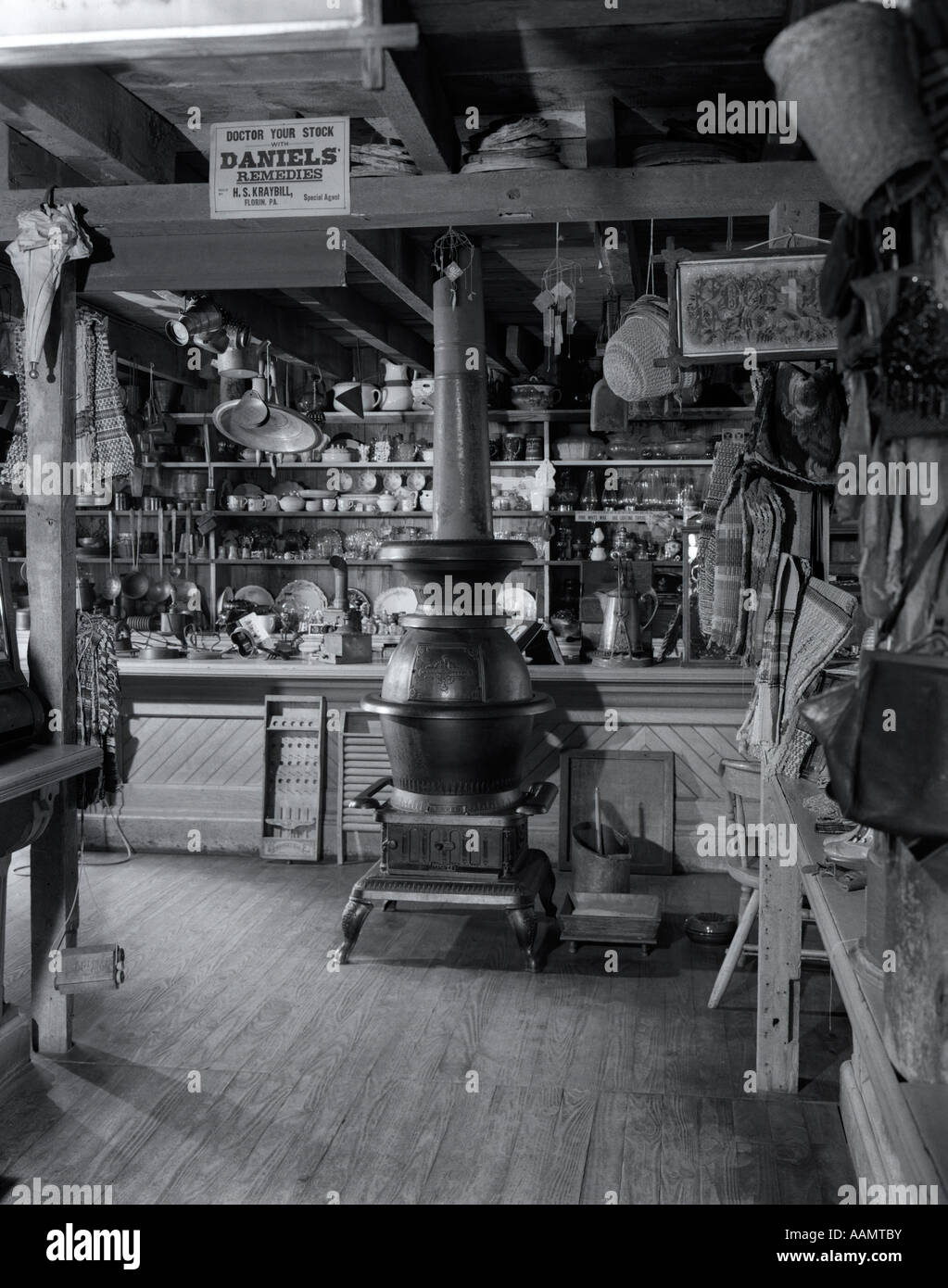 1930s COUNTRY GENERAL STORE INTERIOR WITH CAST IRON POTBELLY STOVE ...