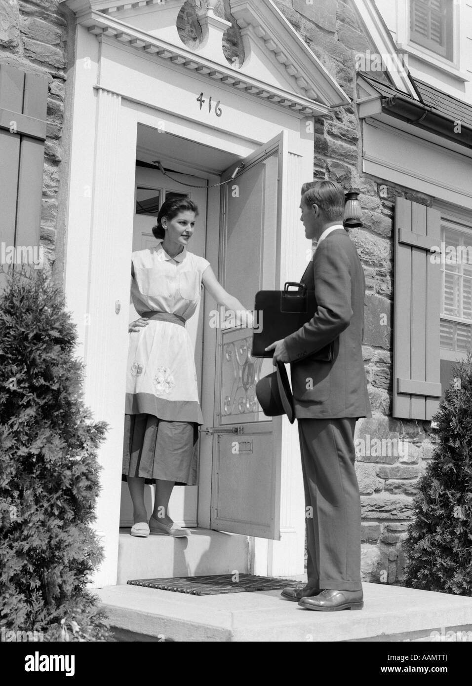 1950s salesman at door talking to housewife stock photo for Door to door salesman