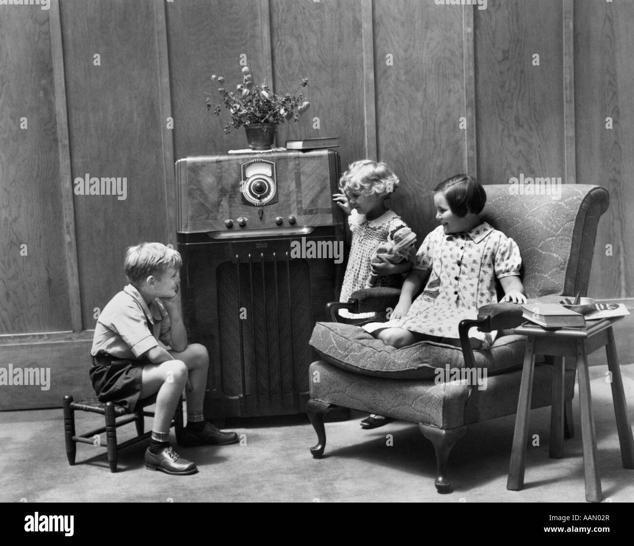 Living Room 1930s 1930s three children two boys one girl back view stepping into