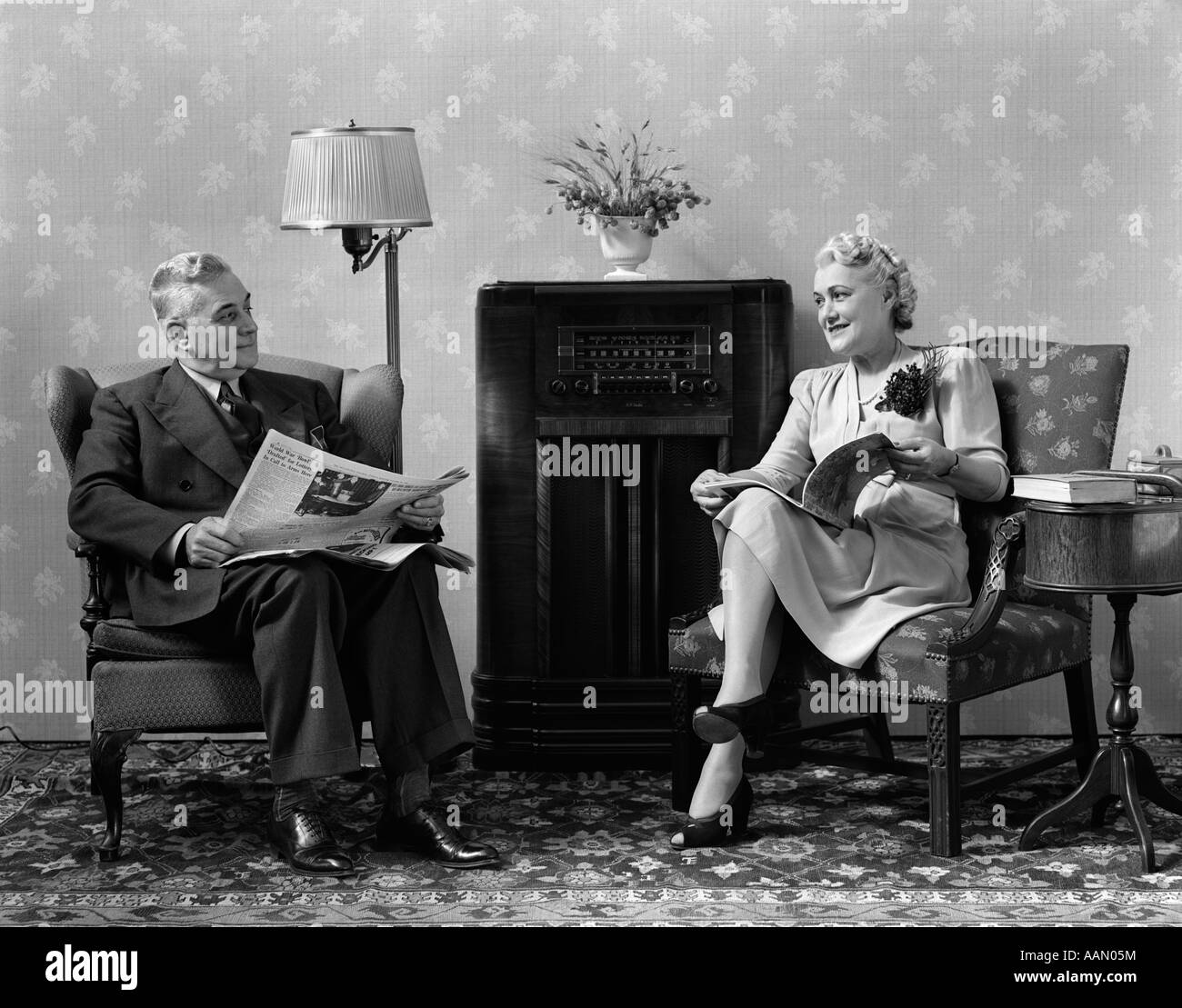 Living Room 1940s 1940s senior couple sitting in living room reading newspaper and