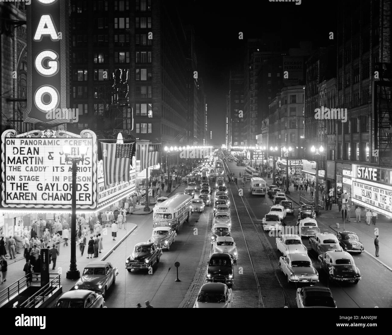 1950s 1953 NIGHT SCENE OF CHICAGO STATE STREET WITH
