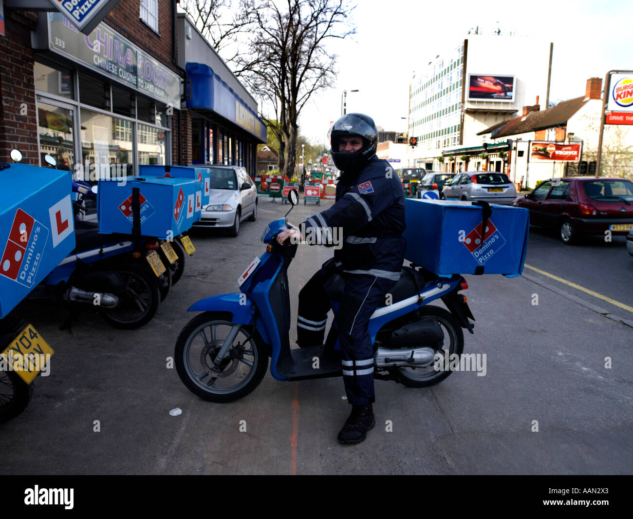 Pizza Delivery Man Sitting on Motor Bike Dominos Pizza ...