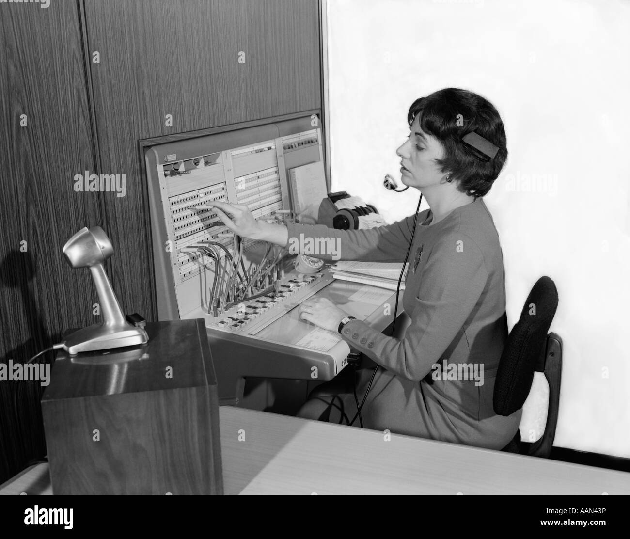 telephone switchboard stock photos telephone switchboard stock 1960s w office telephone switchboard operator wearing headset transferring call receptionist answering service stock image