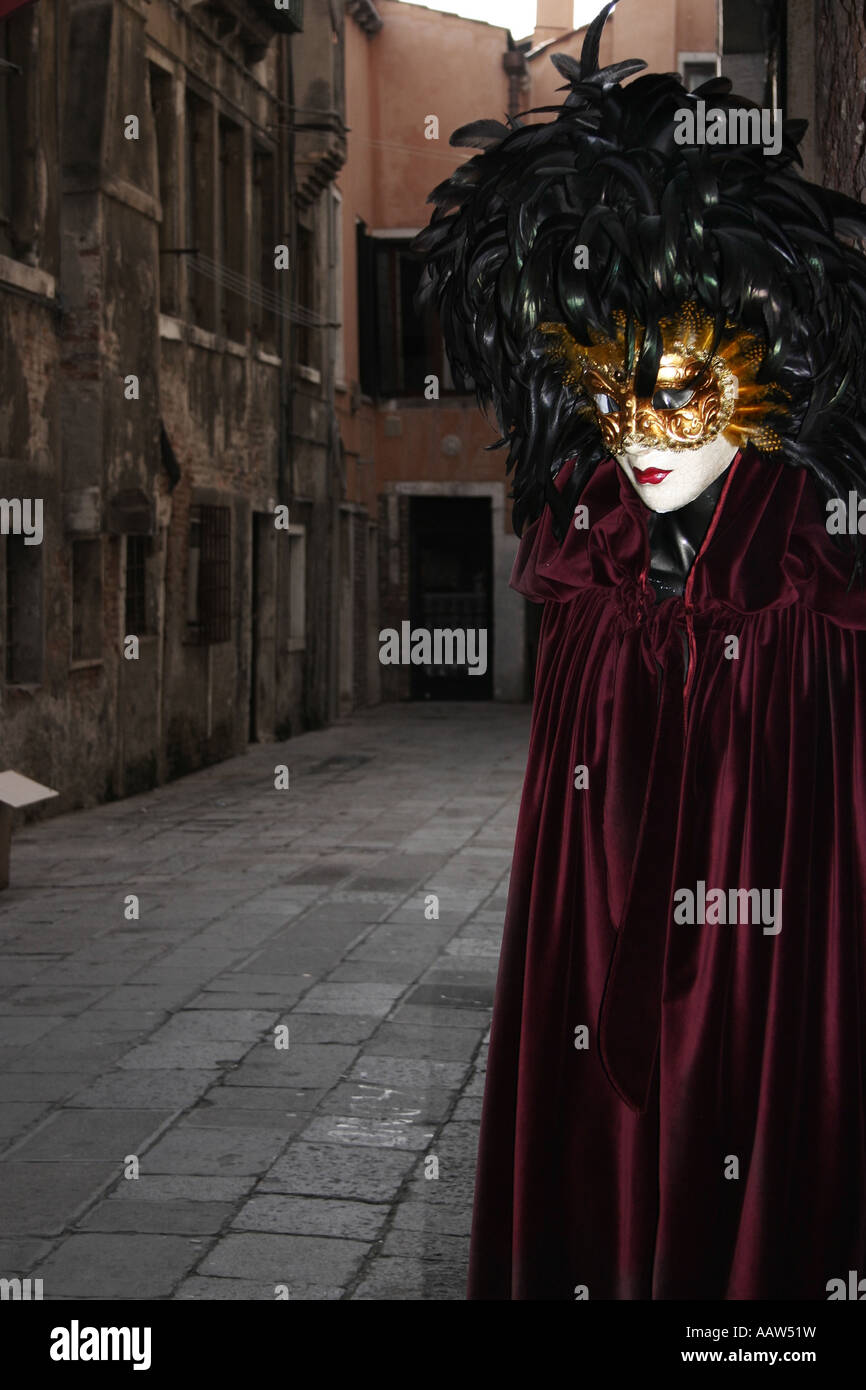Sinister mask and cloak in a side alley, Venice, Italy Stock Photo ...