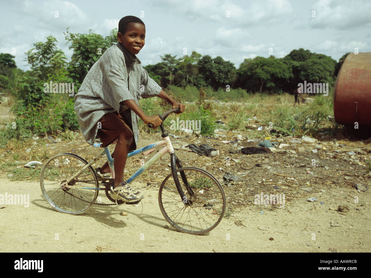 Liberian Boy On A Poor Bike With No Tyres Stock Photo Royalty