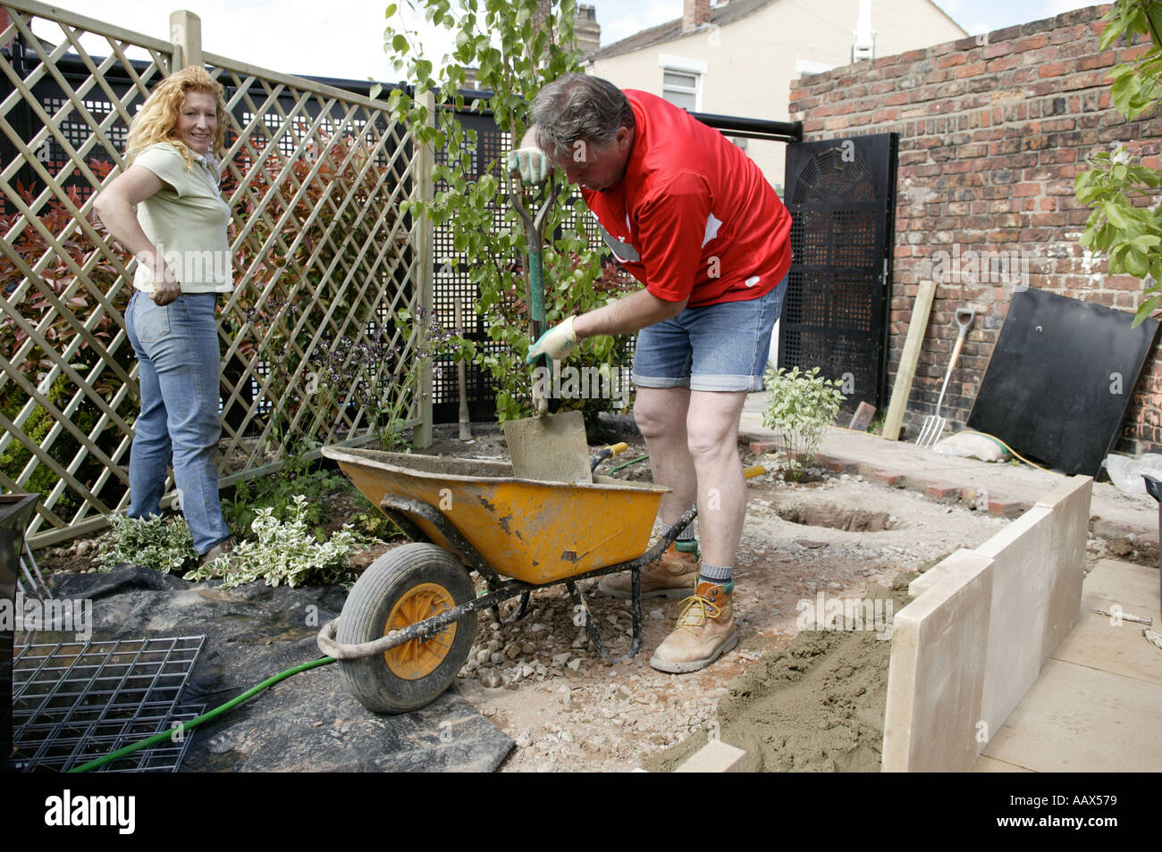 Charlie dimmock and tommy walsh working on a garden a for Ground force garden designs