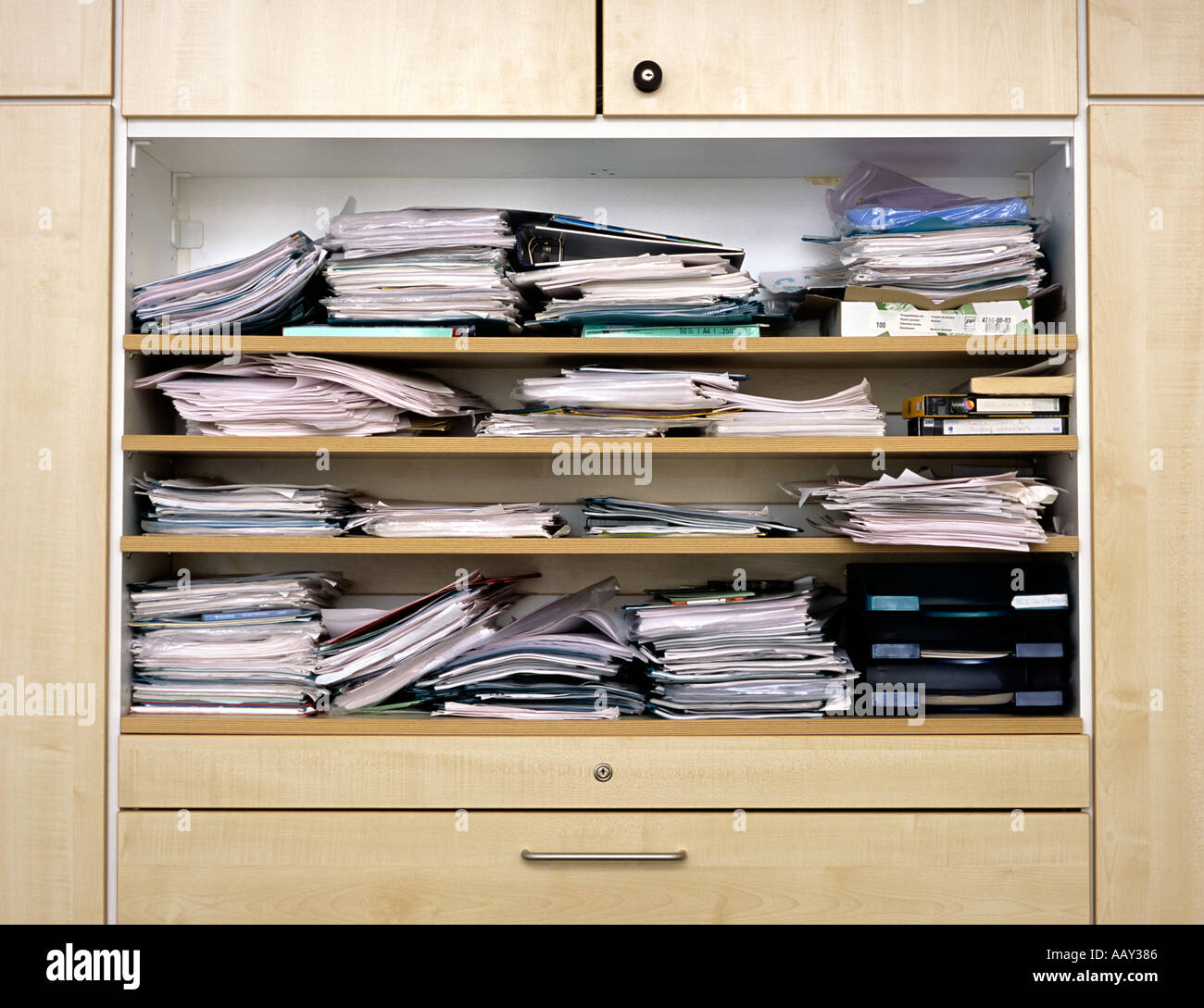 messy file cabinet. Close Up Of Filing Cabinet With Messy Piles Papers File