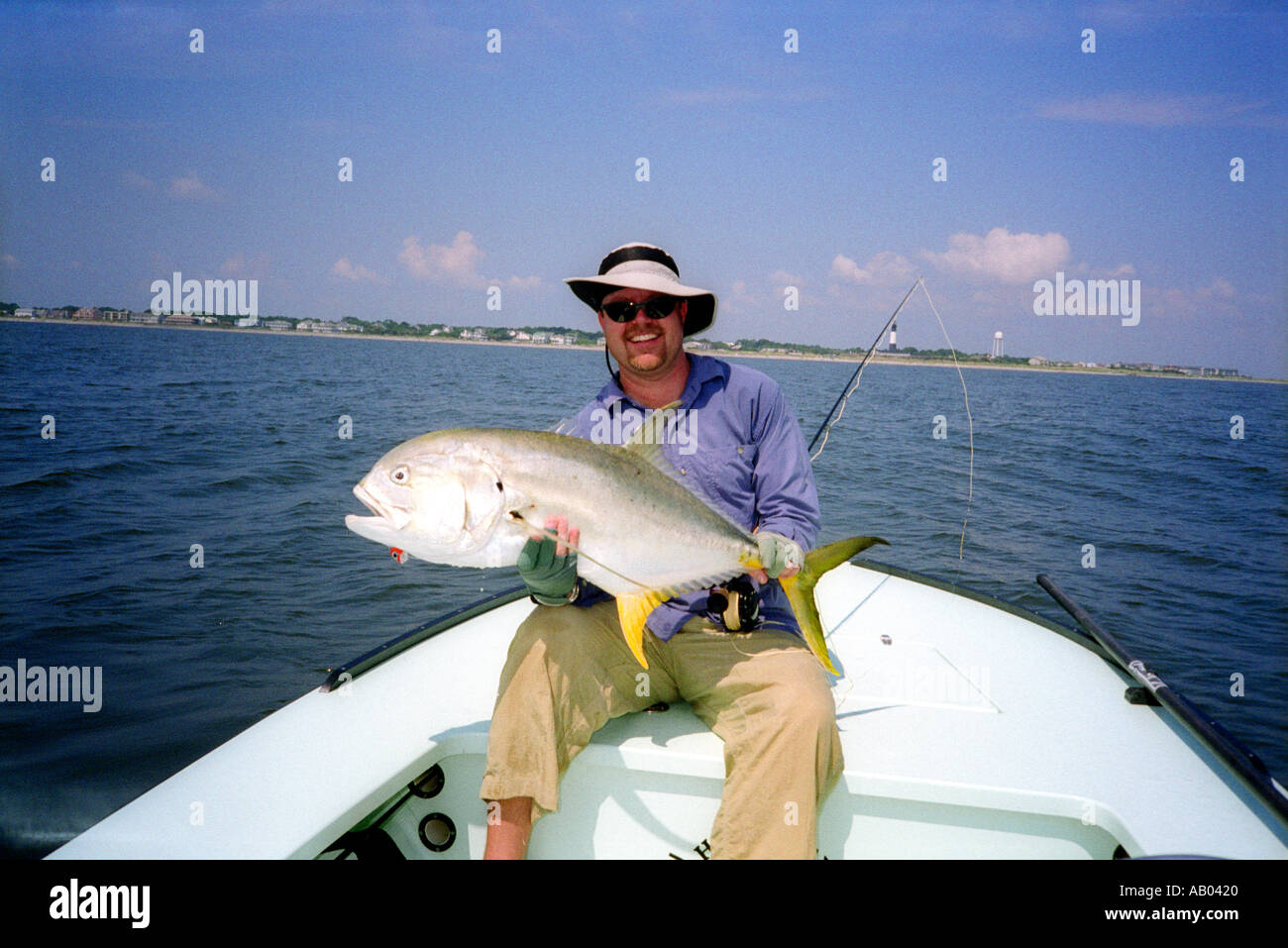 Man holding crevalle jack fish caught while fly fishing in for Fly fish usa