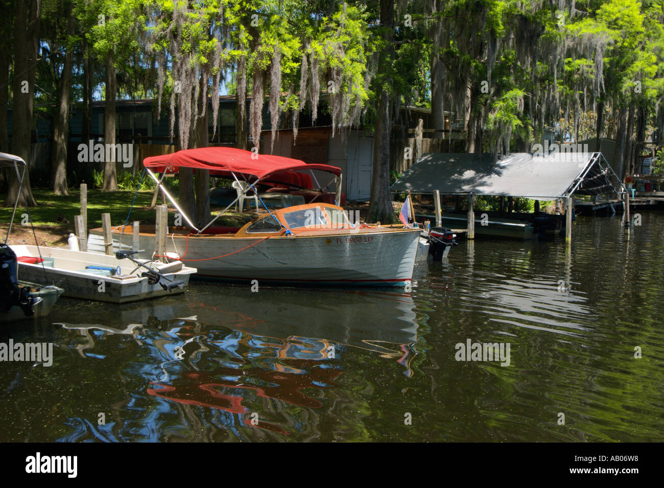 Wooden Boat With Bright Red Canopy at Lake Rousseau Florida & Wooden Boat With Bright Red Canopy at Lake Rousseau Florida Stock ...