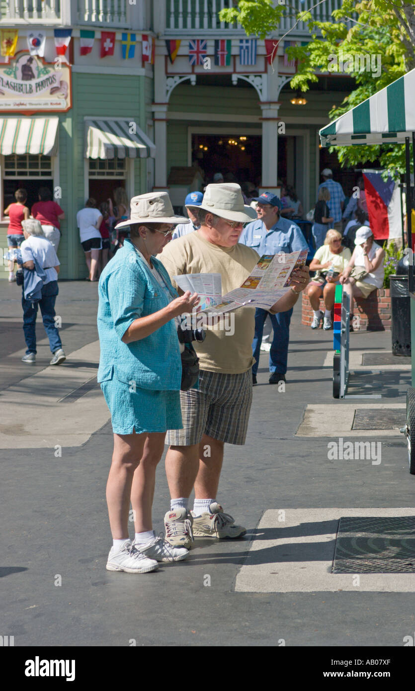Park Guests Studying Map Of Dollywood Theme Park At Pigeon Forge Tennessee Usa